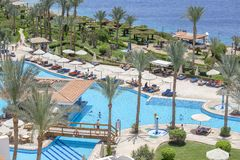 People rest in swimming pool near red sea in hotel, Sharm El Sheikh, Egypt stock image