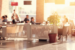 People in the restaurant. Blurred effect applied royalty free stock photo