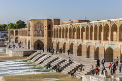 People resting in the ancient Khaju Bridge, (Pol-e Khaju), in Isfahan, Iran Royalty Free Stock Photography