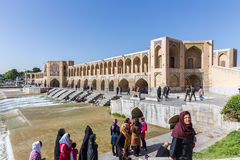 People resting in the ancient Khaju Bridge, (Pol-e Khaju), in Isfahan, Iran Royalty Free Stock Photo