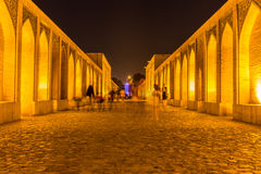 People resting in the ancient Khaju Bridge, (Pol-e Khaju), in Isfahan, Iran Stock Photo