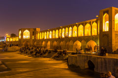 People resting in the ancient Khaju Bridge, (Pol-e Khaju), in Isfahan, Iran Royalty Free Stock Image
