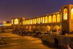 People resting in the ancient Khaju Bridge, (Pol-e Khaju), in Isfahan, Iran Royalty Free Stock Image