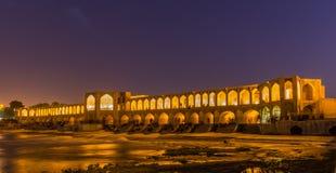 People resting in the ancient Khaju Bridge, (Pol-e Khaju), in Isfahan, Iran Stock Images