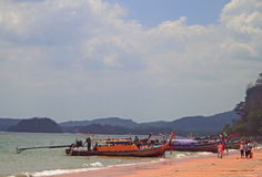 people are resting on Ao Nang beach in Thailand Stock Photo