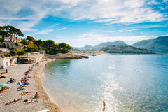 People resting at beach in Cassis, France. Royalty Free Stock Image