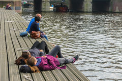 People resting at berth near the water in Amsterdam Stock Photo