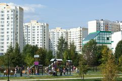 People resting in Butovo park, estate buildings on background, Moscow, Russia royalty free stock images