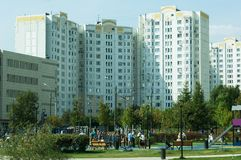 People resting in Butovo park, estate buildings on background, Moscow, Russia stock image