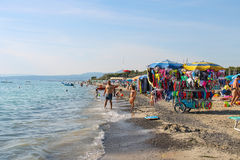 People resting on the coast of the Ligurian Sea. Vada, Italy. Vada, Italy - June 29, 2015: People resting on the coast of the Ligurian Sea (Pietrabianca Beach) Stock Photography