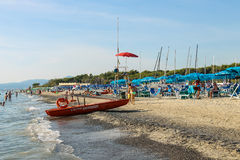 People resting on the coast of the Ligurian Sea. Vada, Italy. Vada, Italy - June 29, 2015: People resting on the coast of the Ligurian Sea (Pietrabianca Beach) Stock Images