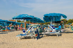 People resting on the coast of the Ligurian Sea. Vada, Italy. Vada, Italy - June 29, 2015: People resting on the coast of the Ligurian Sea (Pietrabianca Beach) Royalty Free Stock Images
