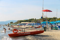 People resting on the coast of the Ligurian Sea. Vada, Italy. Vada, Italy - June 29, 2015: People resting on the coast of the Ligurian Sea (Pietrabianca Beach) Stock Photos