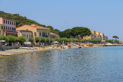 People resting on the coast of the Tyrrhenian Sea, Elba Island. Royalty Free Stock Photos