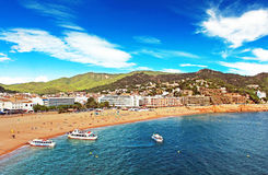 People are resting in european village Tossa de Mar, Spain Royalty Free Stock Images