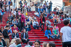 People resting on famous red stairs on Times Square Stock Photos