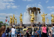People are resting at the Friendship of Peoples fountain at VDNKh All-Russian Exhibition Center on Victory Day. MOSCOW, RUSSIA - MAY 9, 2016:People are resting royalty free stock images