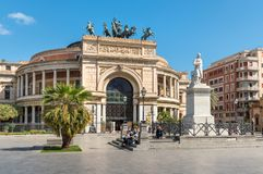 People resting in front of famous Politeama Garibaldi theater in Palermo. Stock Photography