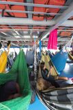 People resting in hammocks on passenger boat deck, Brazil Royalty Free Stock Photography