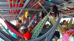 People resting in hammocks on passenger boat deck, Brazil. People resting in hammocks on passenger boat deck going down the Amazon river between Leticia/ stock video footage
