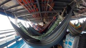 People resting in hammocks on passenger boat deck, Brazil stock video