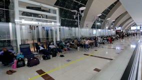 People resting inside airport Dubai stock video footage