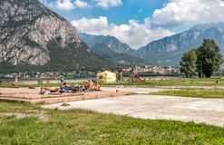 People resting on the Lakefront of Malgrate located on the shore of Como Lake in province of Lecco. Malgrate, Lombardy, Italy - August 28, 2015: People resting Royalty Free Stock Photo
