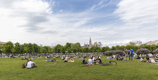 People resting on the lawn at the Stock Images