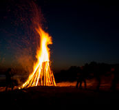 People resting near big bonfire outdoor Stock Images