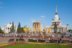 People resting near fountain in  Moscow Stock Image