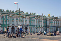 People are resting near Hermitage on Palace Square. Saint Petersburg, Russia - May 30, 2015: People are resting near Hermitage on Palace Square Royalty Free Stock Images