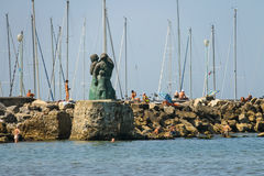 People resting near the monument to the sailors family in Viareg Stock Image