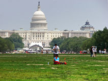 People are resting near United States Capitol building in Washington DC, USA Royalty Free Stock Photo