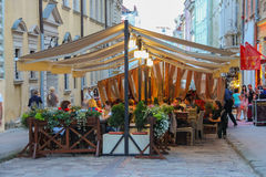 People resting in outdoor cafe in city centre. Lviv, Ukraine Royalty Free Stock Photography