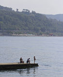 People are resting on a pier in Khosta, Russia royalty free stock photography