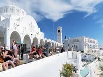 People resting on Promenade of Fira at Santorini Greece Royalty Free Stock Image