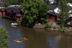 People resting on the river in Porvoo, Finland Stock Photos