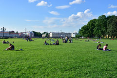 People resting on Senate square in St. Petersburg, Russia Stock Images