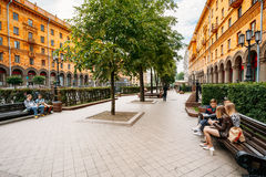 People resting, sitting on bench on Lenin Street Royalty Free Stock Images