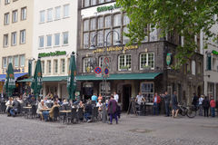 People resting in the street restaurant in Cologne, Germany Royalty Free Stock Photography
