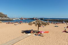 People are resting on a sunny day at the beach in Machico. Madeira Island, Royalty Free Stock Photos