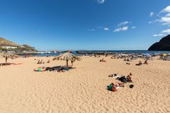 People are resting on a sunny day at the beach in Machico. Madeira Island Royalty Free Stock Photography