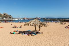 People are resting on a sunny day at the beach in Machico. Madeira Island Stock Images