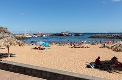 People are resting on a sunny day at the beach in Machico. Madeira Island Royalty Free Stock Photo
