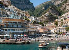 People are resting on a sunny day at the beach in Positano on Amalfi Coast in the region Campania, Italy Stock Photo