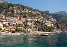 People are resting on a sunny day at the beach in Positano on Amalfi Coast in the region Campania, Italy Royalty Free Stock Images