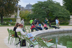 People resting in the Tuileries Garden in Paris Stock Image