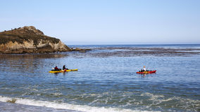 People ridding banana boats in the bay Royalty Free Stock Photography