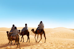 People ridding by camel Royalty Free Stock Photo