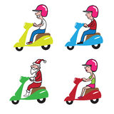 People ridding scooter 1 Stock Image